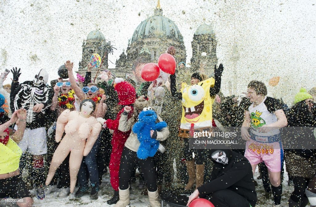 Participants in a flashmob dance an improvised version of the Harlem Shake as they throw confetti in the air in front of the Berlin cathedral February 20, 2013. The flashmob was called in an effort to gather as many people as possible and perform the Harlem Shake in sub-zero temperatures.