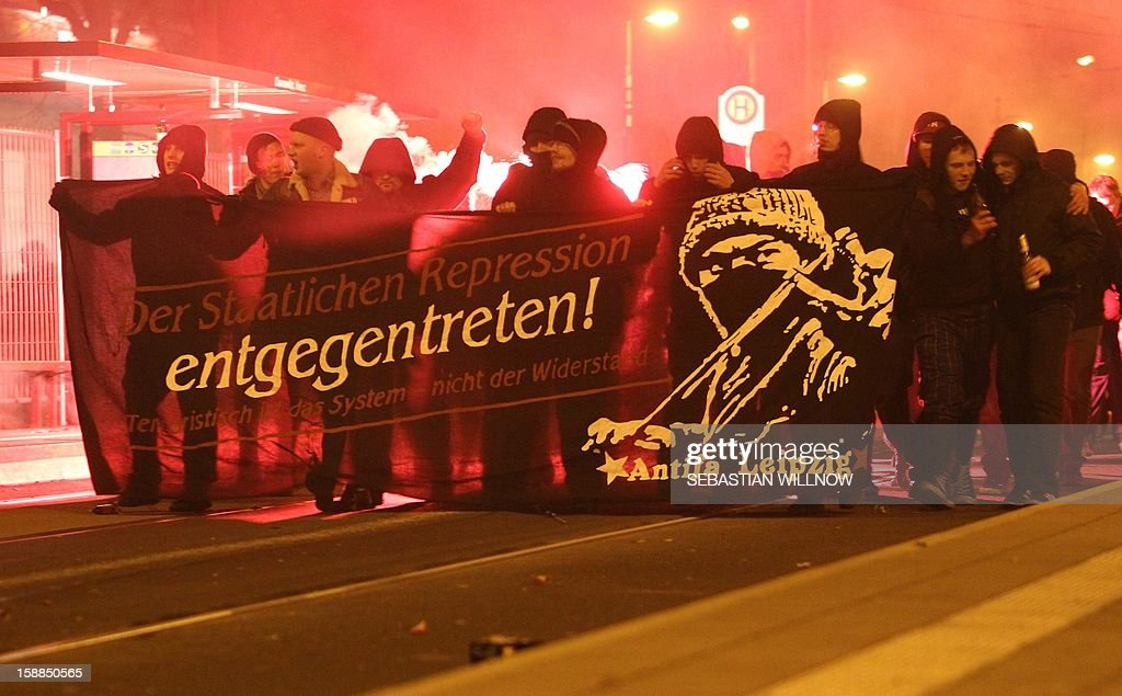 Participants in a spontaneous demonstration walk with a banner reading ' No to the state repression' on January 1, 2013 in Leipzig, eastern Germany. AFP PHOTO / SEBASTIAN WILLNOW /Germany Out