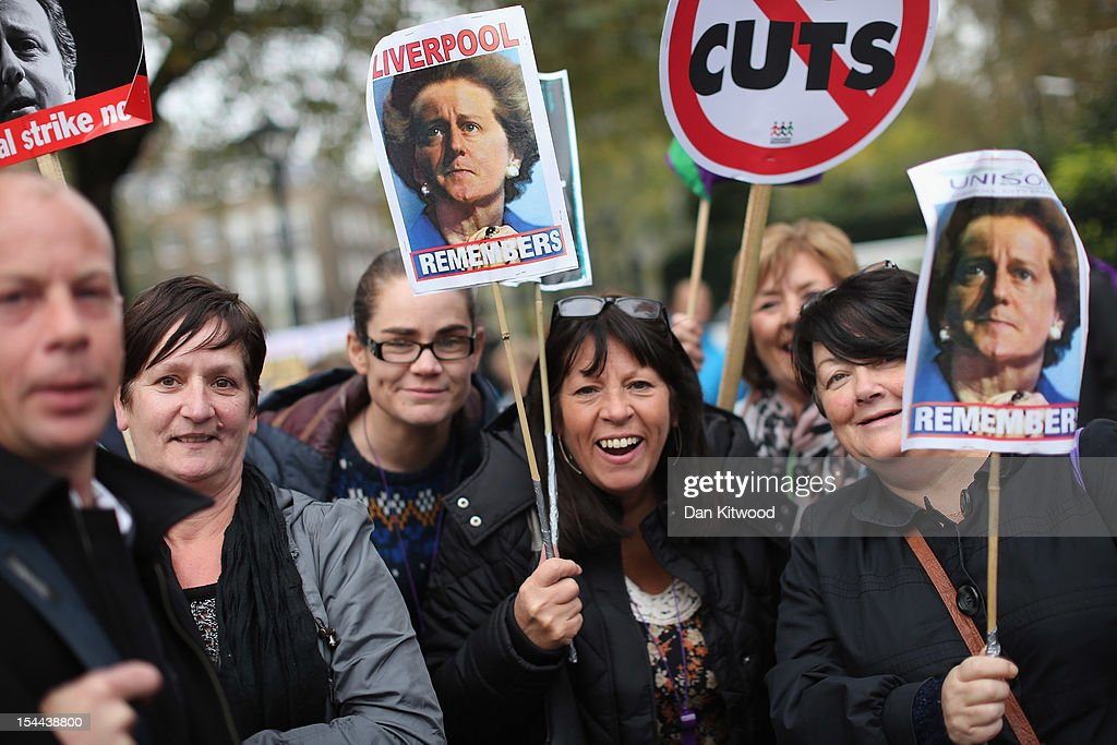 Participants in a TUC march in protest against the government's austerity measures hold up placards featuring pictures of the merged faces of current and previous Conservative Prime Ministers <a gi-track='captionPersonalityLinkClicked' href=/galleries/search?phrase=David+Cameron+-+Politician&family=editorial&specificpeople=227076 ng-click='$event.stopPropagation()'>David Cameron</a> and Margaret Thatcher, prepare to set off from the Embankment on October 20, 2012 in London, England. Thousands of people are taking part in the Trades Union Congress (TUC) organised anti-cuts march that ends with a rally in Hyde Park, where Labour leader Ed Miliband is scheduled to address the demonstrators.