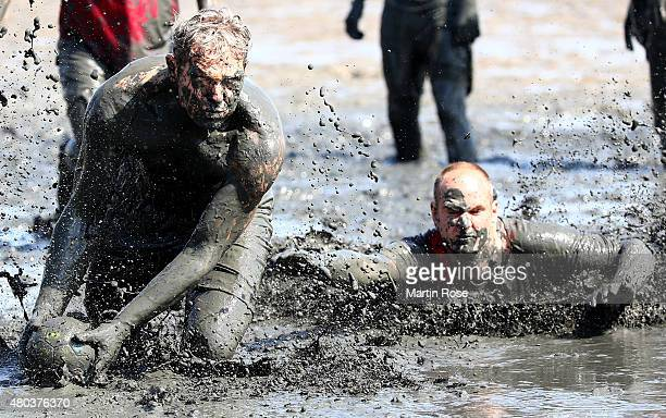 Participants in action during the Mudflat Olympic Games on July 11 2015 in Brunsbuettel Germany