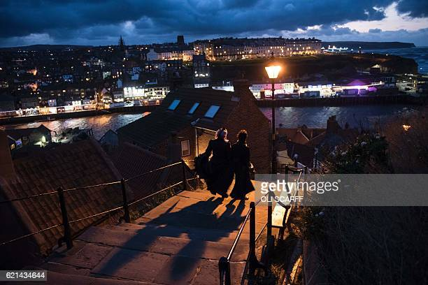 Participants in costume attend the biannual 'Whitby Goth Weekend' festival in Whitby northern England on November 6 2016 The festival brings together...