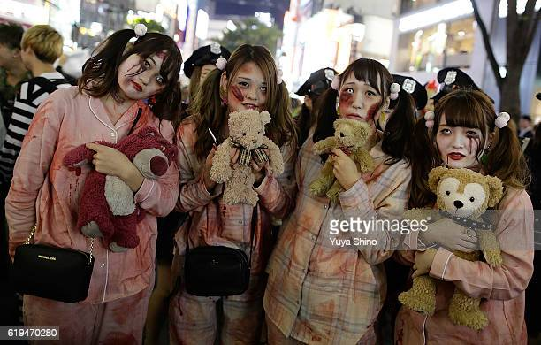Participants in costume pose for a photograph during Halloween celebrations at Shibuya district on October 31 2016 in Tokyo Japan