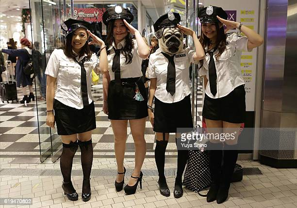 Participants in costume pose for a photograph during Halloween celebration at Shibuya district on October 31 2016 in Tokyo Japan
