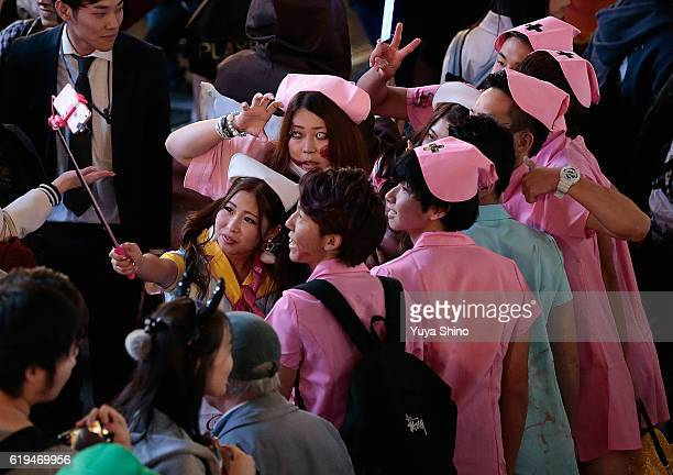 Participants in costume pose for a selfie photo during Halloween celebrations at Shibuya district on October 31 2016 in Tokyo Japan