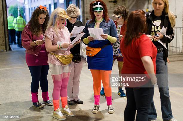 Participants in costume wait in the holding area ahead of the last of three nights of the zombie chase game '28 Hours Later' in central Manchester...