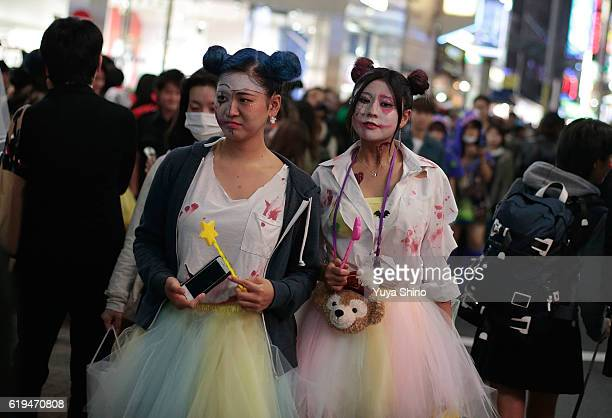 Participants in costume walk on a street during Halloween celebration at Shibuya district on October 31 2016 in Tokyo Japan