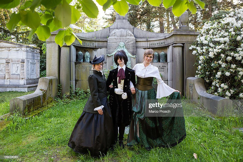Participants in costumes pose for pictures at the South Cemetery on the second day of the annual Wave-Gotik Treffen, or Wave and Goth Festival, on May 18, 2013 in Leipzig, Germany. The four-day festival, in which elaborate fashion is a must, brings together over 20,000 Wave, Goth and steam punk enthusiasts from all over the world for concerts, readings, films, a Middle Ages market and workshops.