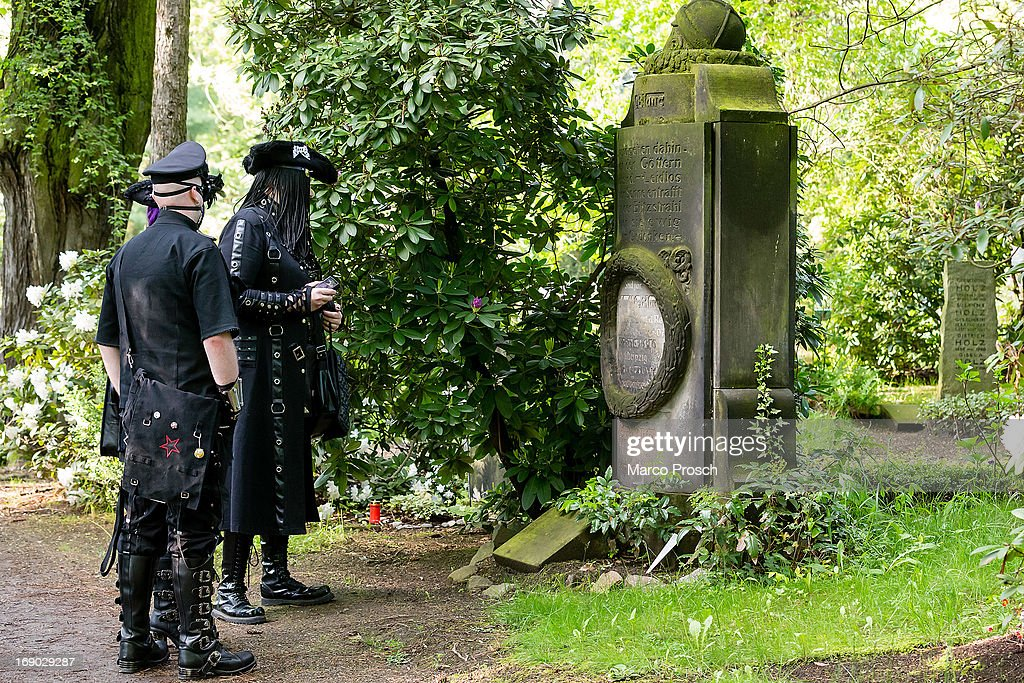 Participants in goth and steam punk outfits visit the South Cemetery on the second day of the annual Wave-Gotik Treffen, or Wave and Goth Festival, on May 18, 2013 in Leipzig, Germany. The four-day festival, in which elaborate fashion is a must, brings together over 20,000 Wave, Goth and steam punk enthusiasts from all over the world for concerts, readings, films, a Middle Ages market and workshops.