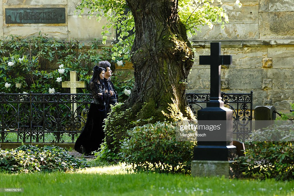 Participants in goth clothing visit the South Cemetery on the second day of the annual Wave-Gotik Treffen, or Wave and Goth Festival, on May 18, 2013 in Leipzig, Germany. The four-day festival, in which elaborate fashion is a must, brings together over 20,000 Wave, Goth and steam punk enthusiasts from all over the world for concerts, readings, films, a Middle Ages market and workshops.