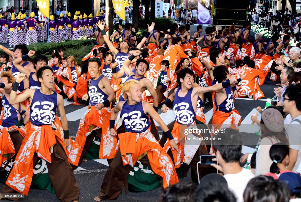 Participants in Nippon Domannaka Festival (Domatsuri) parade dancing on streets of central Nagoya on August 26, 2012 in Nagoya, Aichi, Japan.