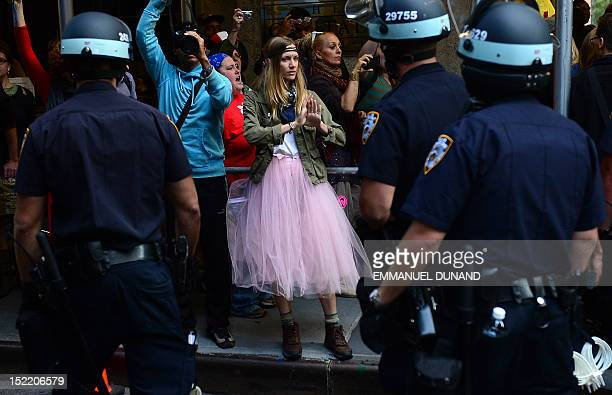 Participants in Occupy Wall Street protest take part in a rally to mark the one year anniversary of the movement in New York September 17 2012 Police...