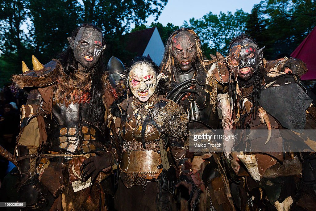 Participants in Orc costumes pose for the camera on the second day of the annual Wave-Gotik Treffen, or Wave and Goth Festival, on May 18, 2013 in Leipzig, Germany. The four-day festival, in which elaborate fashion is a must, brings together over 20,000 Wave, Goth and steam punk enthusiasts from all over the world for concerts, readings, films, a Middle Ages market and workshops.