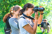 Participants in a course in nature photography outdoors