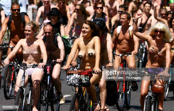Participants in the Brighton leg of the World Naked Bike Ride move through the streets of Brighton East Sussex to demonstrate the vulnerability of...