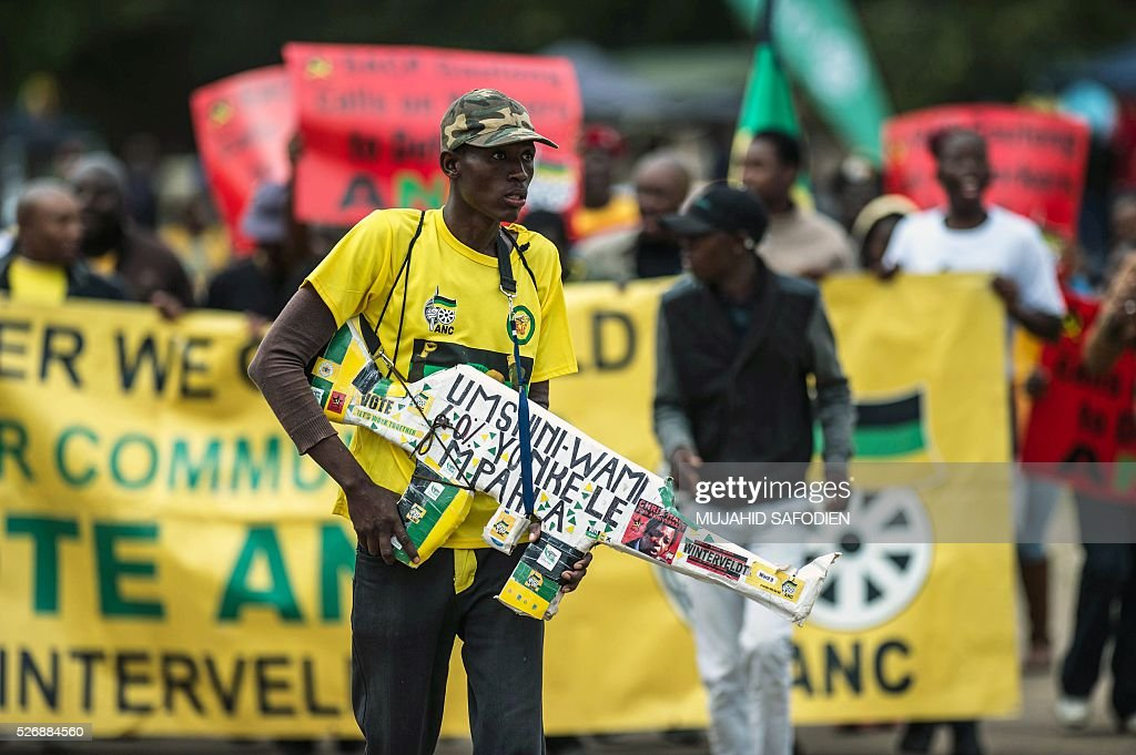 Participants in the congress of South African Trade Unions (COSATU) attend the May Day rally at Mamelodi's Moreleta park on May 1, 2016 in Pretoria. Secretary General Sdumo Dlamini, South African Communist Party leader Blade Nzimande and South African President Jacob Zuma took part in the rally. / AFP / MUJAHID