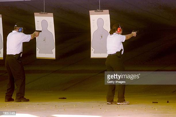 Participants in the first class of commercial airline pilots who volunteered to carry handguns practice firing April 17 2003 in Glynco Georgia as...