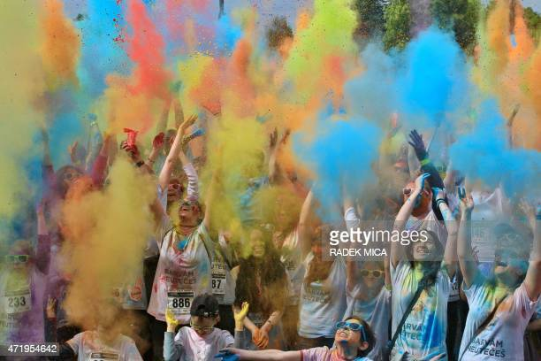 Participants in the fun Color Run are covered with powder in Olomouc Central Moravia Czech Republic The run celebrates the coming of spring AFP...
