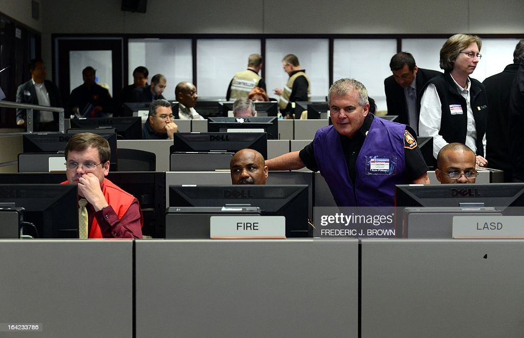 Participants in the News and Information office take calls to pass on information in a room at the Command Center of the Office of Emergency Management in Los Angeles, California, during a functional exercise for first responders in a simulated 7.8 magnitude earthquake drill on March 21, 2013. This year's exercise featured the California Integrated Seismic Network's Earthquake Early Warning Demonstration System and participation from 53 City emergency operations centers, including some departments and organizations such as Fire, Water, Coroner, Sheriff and Public Works as well as the American Red Cross and Emergency Network Los Angeles. The functional exercise is a training event designed to test and evaluate selected emergency functions and the interaction of various levels of government, response organizations, volunteer groups, and industry in a simulated environment, usually involving key decision makers, the local emergency operations center and representatives from response and support organizations. AFP PHOTO/Frederic J. BROWN