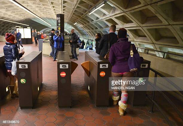 Participants in the No Pants Subway Ride DC enter through the turnstiles at the L'Enfant Plaza station on January 11 2015 in Washington DC The No...
