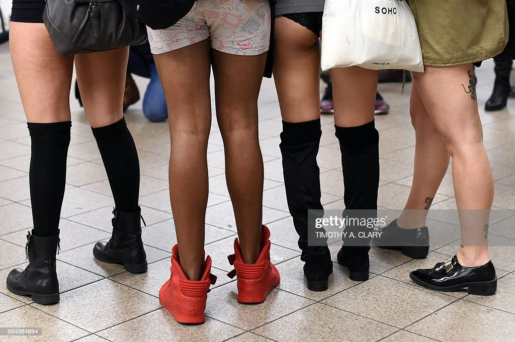Participants in the 'No Pants Subway Ride' stand on a New York City subway platform January 10 2016 in New York The 'No Pants Subway Ride' is an...