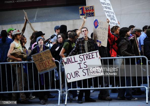 Participants in the Occupy Wall Street demonstrate on Wall Street in an attempt to disrupt pedestrian flow for financial workers to get to work in...