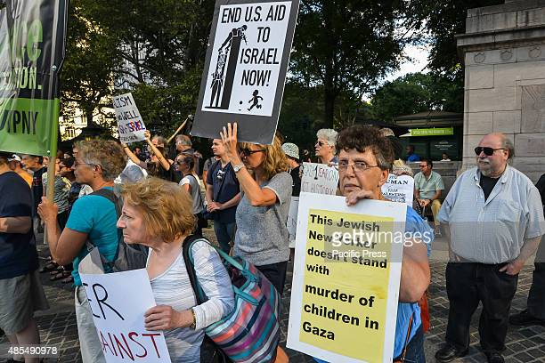 Participants in the rally and march display their signs to passersby at the concluding rally in Columbus Circle Demonstrators rallied at the American...