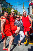 Participants in the Red Dress Bar crawl an AIDS fundariser pose with tourists on Castro Street Following the Orlando shooting San Francisco Police...
