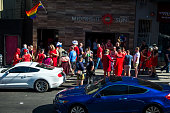 Participants in the Red Dress Bar crawl an AIDS fundraiser pictured outside the Midnight Sun Bar on 18th Street Following the Orlando shooting San...