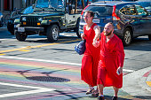 Participants in the Red Dress Bar crawl an AIDS fundraiser pictured on Castro Street Following the Orlando shooting San Francisco Police vow to an...