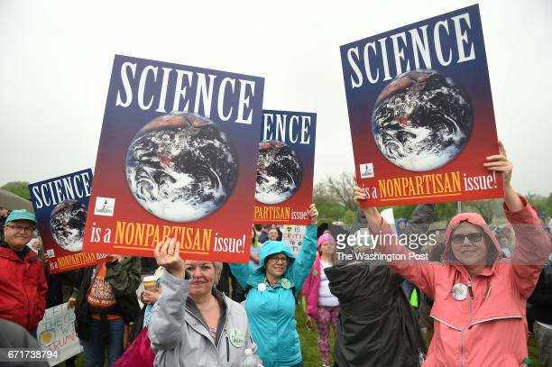 Participants in the Science March on Washington gather at the Washington Memorial before marching to the US Capitol in Washington DC April 22 2017...
