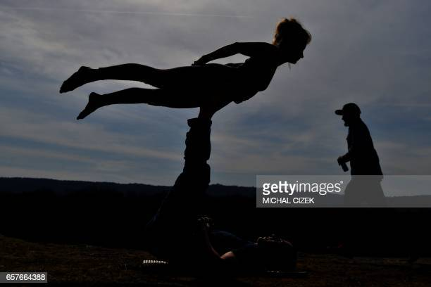 TOPSHOT Participants in the slackline festival are pictured as they warm up at a quarry near Beroun central Bohemia Czech Republic on March 25 2017 /...