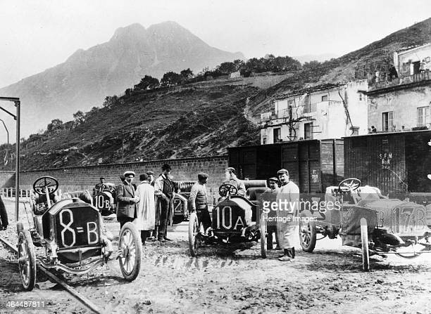 Participants in the Targa Florio race Sicily April 1907 Drivers with their cars chat to each other along a rough muddy road This race was established...