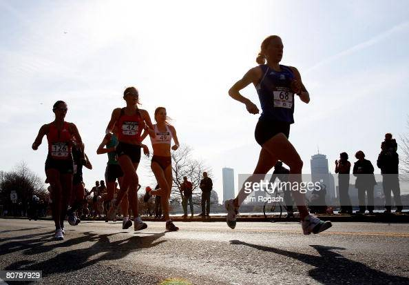 Participants in the US Women's Olympic Marathon Trials run along the Charles River April 20 2008 in Cambridge Massachusetts