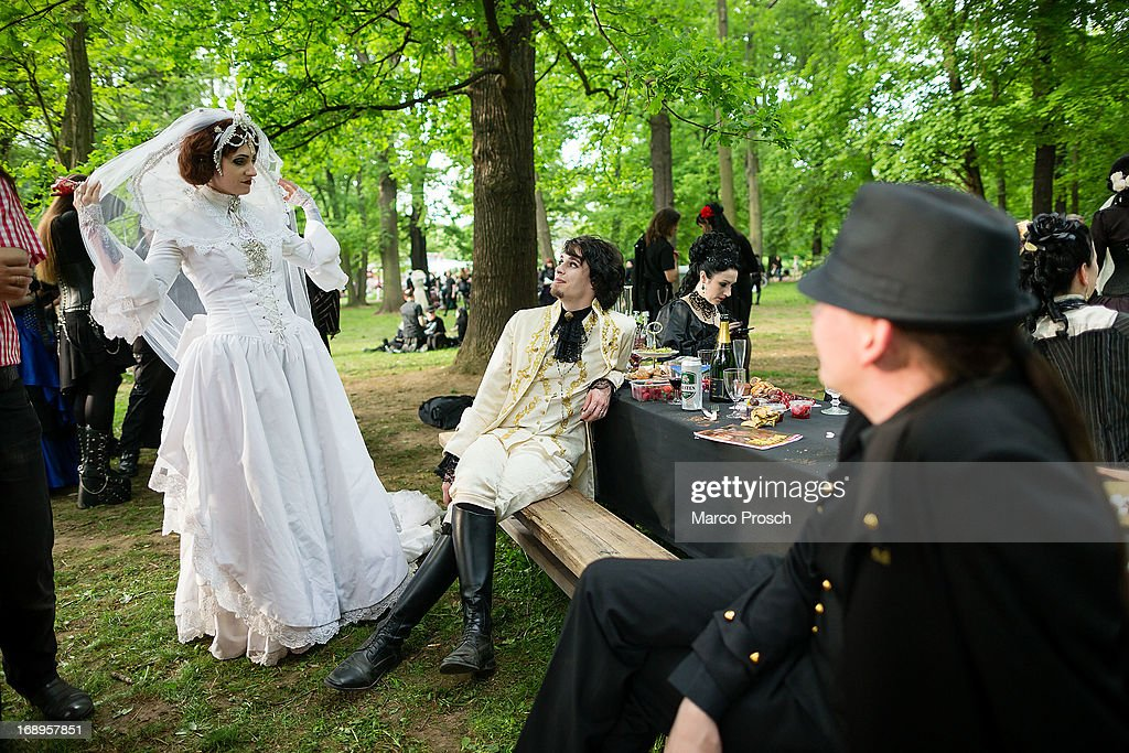 Participants in Victorian clothing attend the traditional park picnic on the first day of the annual Wave-Gotik Treffen, or Wave and Goth Festival, on May 17, 2013 in Leipzig, Germany. The four-day festival, in which elaborate fashion is a must, brings together over 20,000 Wave, Goth and steam punk enthusiasts from all over the world for concerts, readings, films, a Middle Ages market and workshops.