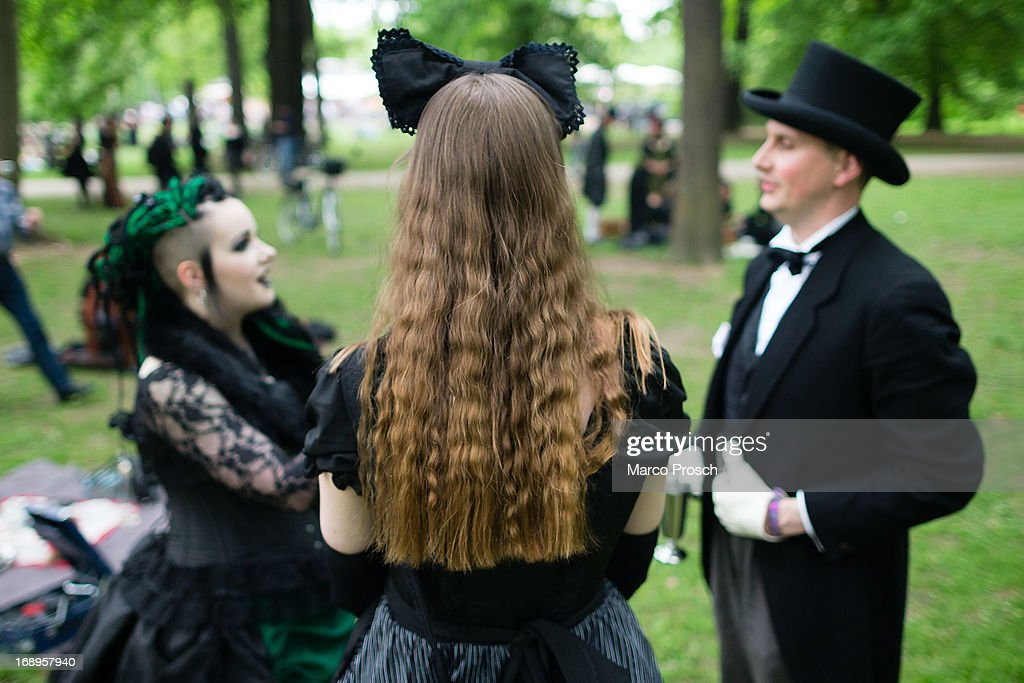 Participants in Victorian clothing chat during the traditional park picnic on the first day of the annual Wave-Gotik Treffen, or Wave and Goth Festival, on May 17, 2013 in Leipzig, Germany. The four-day festival, in which elaborate fashion is a must, brings together over 20,000 Wave, Goth and steam punk enthusiasts from all over the world for concerts, readings, films, a Middle Ages market and workshops.