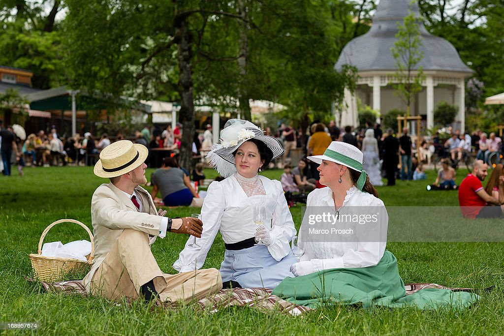Participants in Victorian clothing sit on the lawn and chat during the traditional park picnic on the first day of the annual Wave-Gotik Treffen, or Wave and Goth Festival, on May 17, 2013 in Leipzig, Germany. The four-day festival, in which elaborate fashion is a must, brings together over 20,000 Wave, Goth and steam punk enthusiasts from all over the world for concerts, readings, films, a Middle Ages market and workshops.