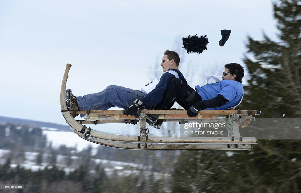Participants jump with their sled during the traditional Schnablerrennen sledge race in a valley near the Bavarian village Gaissach, southern Germany, on January 27, 2013. More than 70 teams took part in the traditional event.