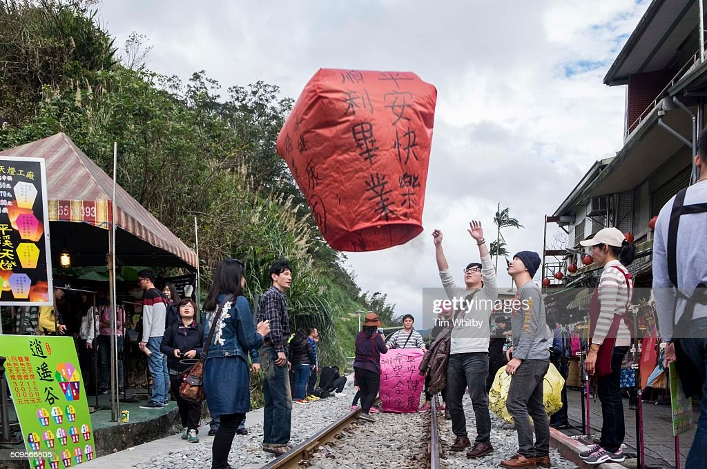 Participants launch a lantern at the Pingxi Sky Lantern Festival on February 11, 2016 in Pingxi District, New Taipei City, Taiwan. The event is the first of three organised lantern releases and falls on the 4th day of the Lunar New Year. The theme for the launch was children and young participants were encouraged to place their fingerprints on their lanterns as a symbolic representation of their wishes.
