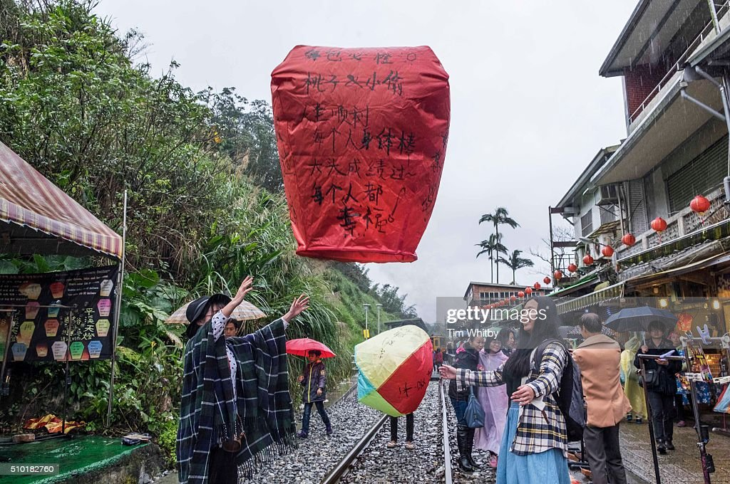 Participants launch a lantern at the Pingxi Sky Lantern Festival on February 14, 2016 in Pingxi District, New Taipei City, Taiwan. The event is the second of three organised lantern releases and the theme for the launch is 'Two Hearts Together'. Participants were encouraged to 'leave their love in Pingxi' and draw hearts on their lanterns.