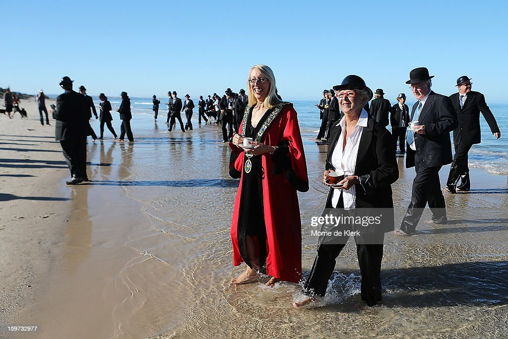 Participants leave the water after taking part in an art installation created by surrealist artist Andrew Baines on January 20, 2013 in Adelaide, Australia.