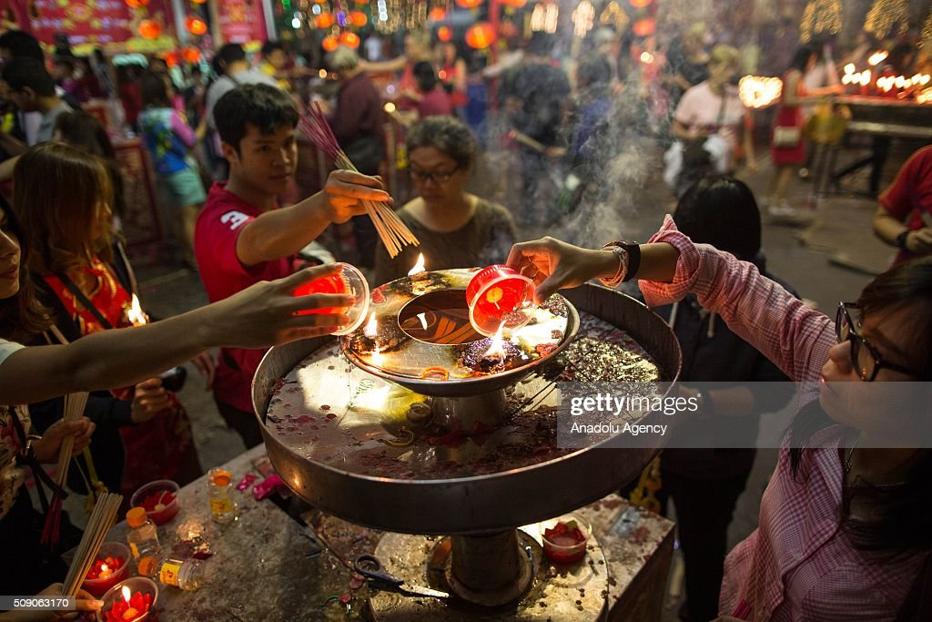 Participants light candle at Chinatown during Chinese New Year celebrations in Bangkok, Thailand on February 8, 2016. The Lunar new year will mark the start of the year of the monkey and will widely celebrated throughout the country where 14 percent of the population is ethnic Chinese.