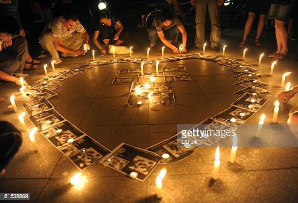 Participants light candles during a memorial event for the dead school children who were killed in the massive May 12 earthquake in Chengdu in...