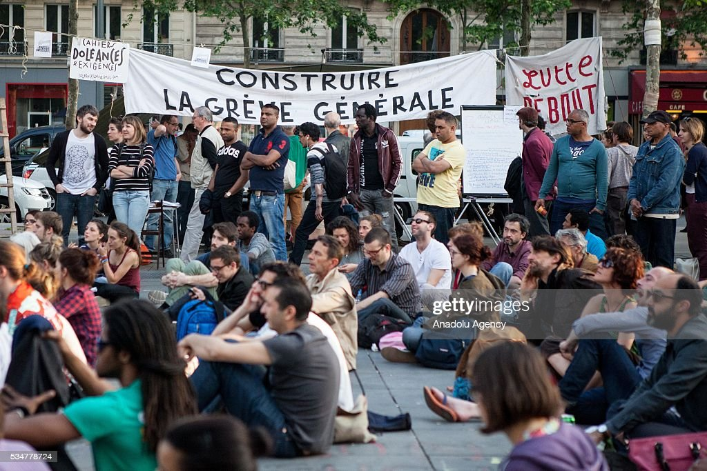 Participants listen to a speech on the Place de la Republique during the Global Debout meeting 'Nuit Debout' ('The Night awake' or Up all night') in Paris, France on May 27, 2016.
