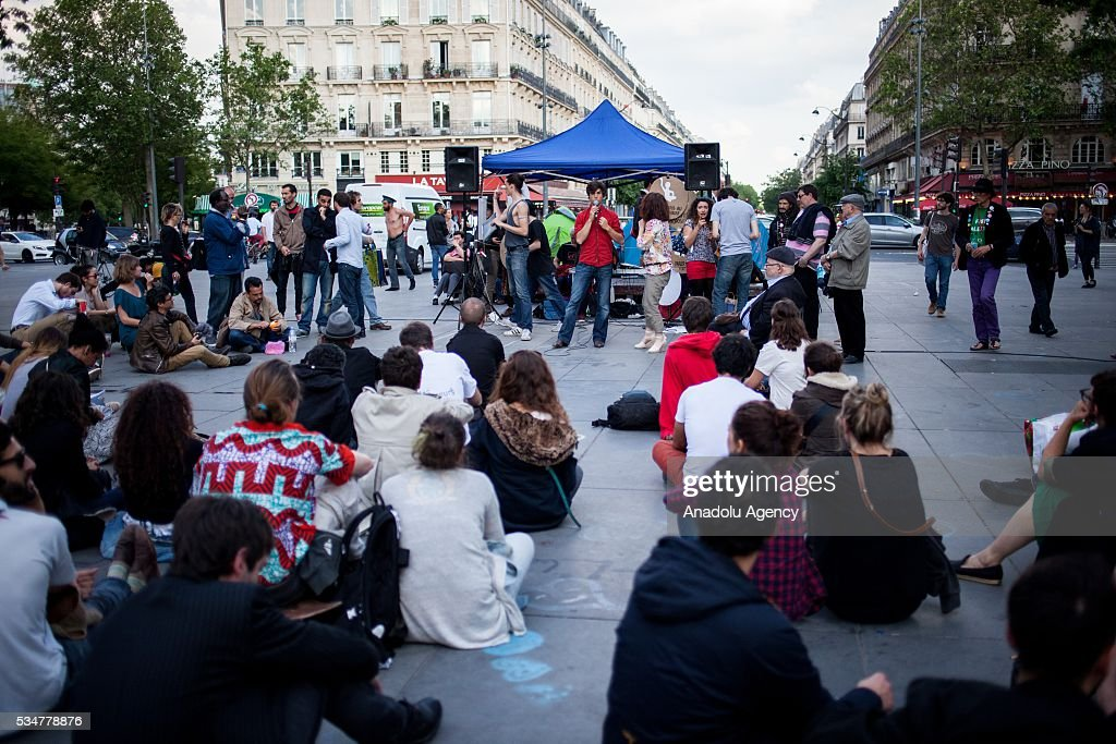 Participants listen to a speech on the Place de la Republique during the Global Debout meeting as the 'Nuit Debout' in Paris, France on May 27, 2016.