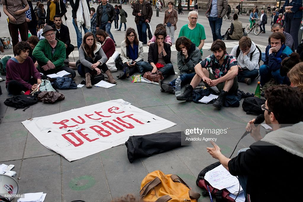 Participants listen to a speech on the Place de la Republique during the Global Debout meeting as the 'Nuit Debout' in Paris, France on May 28, 2016.