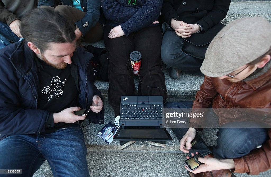 Participants listen to music coming through a speaker made from a Pringles potato chip can on a laptop computer as they wait for the start of a demonstration against Internet copyright restrictions resulting from the Anti-Counterfeiting Trade Agreement (ACTA) in front of the Altes Museum (Old Museum) on April 23, 2012 in Berlin, Germany. ACTA is a proposed treaty attempting to establish an international governing body with legal standards intended to protect intellectual property and prevent the production and sale of counterfeit goods. The German government has delayed a decision on the agreement, citing concerns by the Justice Ministry, and according to news reports is waiting for approval by the European Parliament prior to signing the multinational treaty.