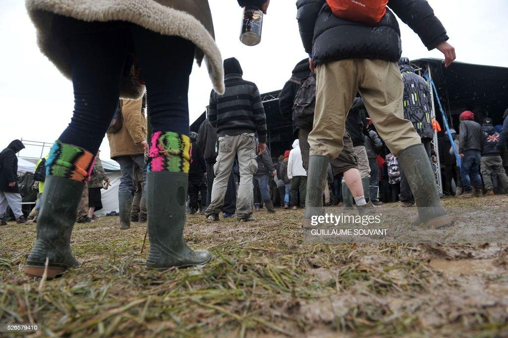 Participants listen to music during the 'Frenchtek 23' Teknival music festival near Salbris, central France on April 30, 2016. / AFP / GUILLAUME