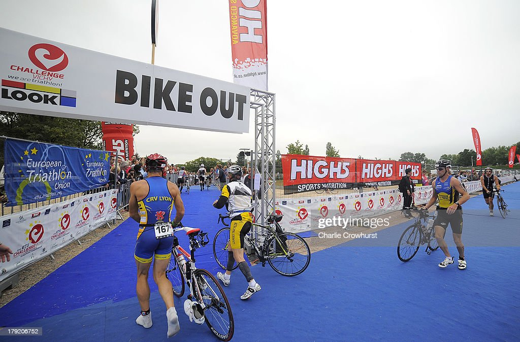 Participants make their way out of the transition area to start the bike ride during the Challenge Triathlon Vichy on September 01, 2013 in Vichy, France.