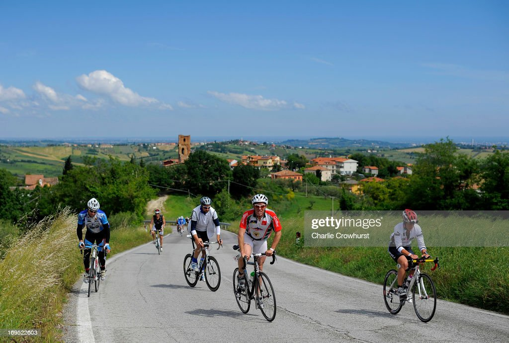 Participants make their way up hill during the Challenge Family Triathlon Rimini on May 26, 2013 in Rimini, Italy.