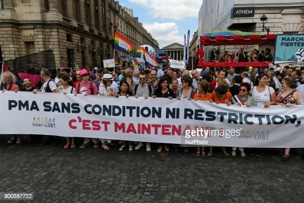 Participants march behind a banner with the inscription « Medically assisted procreation unconditional victory nor limitation it is now » during...